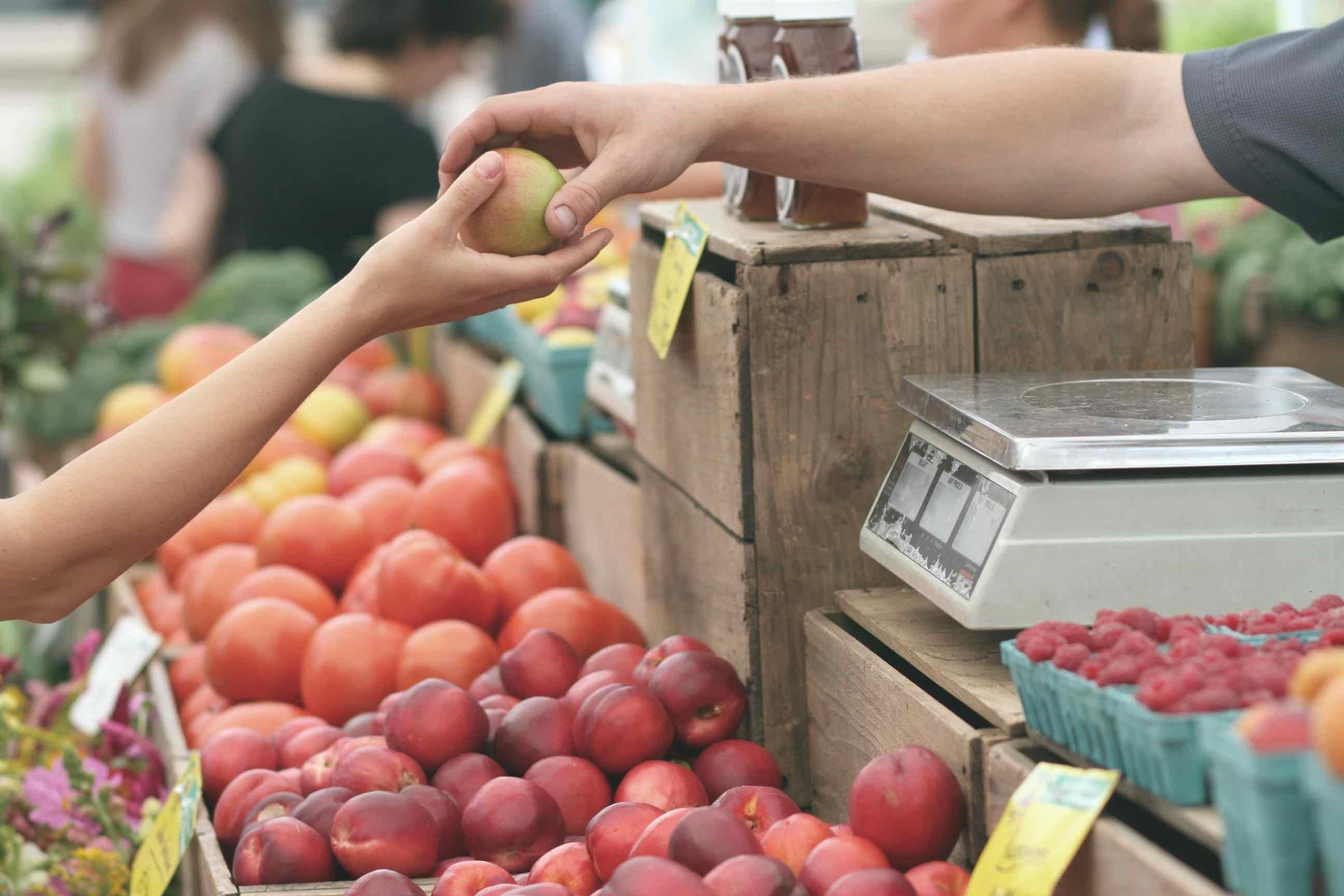 buying fruit at a market